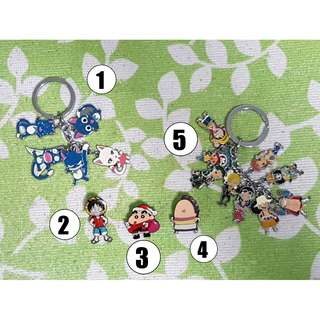 Various Anime Keychains and Pins.