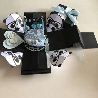 Panda explosion box with cake , 8 waterfall and pull tab in black , blue & silver