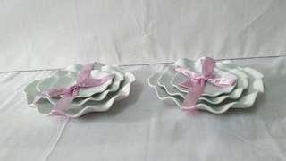 2 sets of 3 size wavy porcelain plates