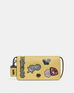 disney x coach dinky with patches. Style no. 32757