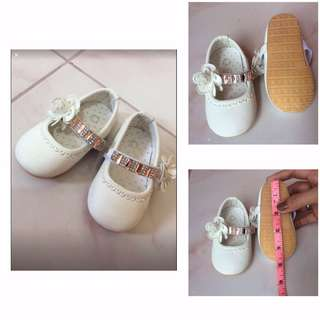 White baby shoes