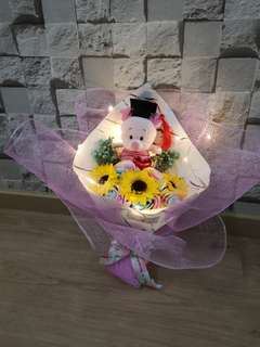 Graduation Bouquet piglet with baby breath, rose and sunflowers