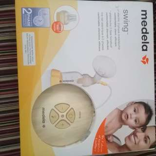 NEW MEDELA SWING (WARRANTY CARD)