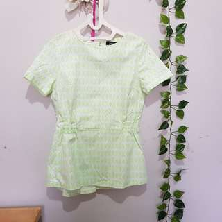 Green peplum linen top