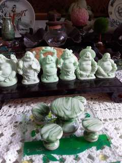 one wooden rack with 6 mini resin laughing budha