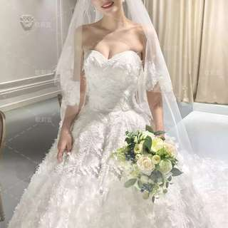 A line wedding gown with fully special feather deco.