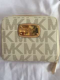 Michael Kors Small wallet with minor flaw shows in the pictures