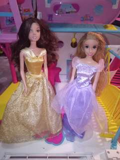Rapunzel and Belle barbie selling them as set