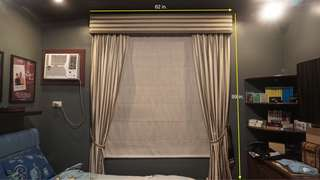 Green Victorian-style curtain 62x99in.