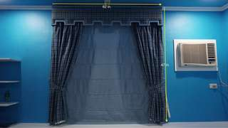 Blue Victorian-style curtain 62x47in.