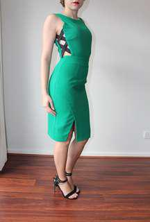 Classy green Seduce dress with a sexy twist.