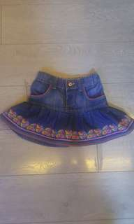 Jeans skirt with cross stitch design