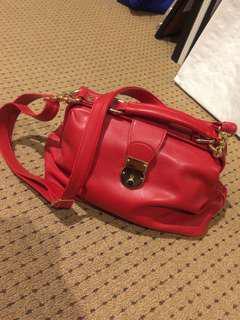 MOUCHE red handbag