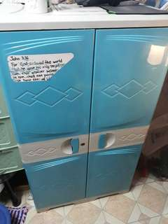 Plastic two door cabinet with drawer