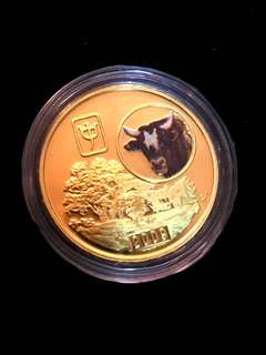 2009 North Korea 20 Won The Chinese Almanac Year of the Cow Coloured Brass Coin Proof Struck. Uncirculated Mint Condition. Very Scarce mintages.