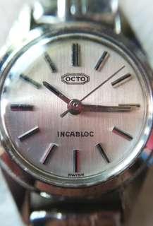 😍50年代尾瑞士製😍 OCTO樂都古董女裝豆零錶,全原裝,銀色布紋面,無番寫,金色17石上鏈機芯,已抹油,行走精神,塑膠上蓋,原裝彈簧鋼錶帶,淨錶,有意請pm