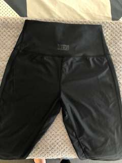 OTZI high waisted leggings with mesh and leather detail