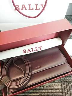 Bally Pouchette with Long Strap Maroon in color.
