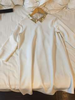 White dress with gold sequined collar