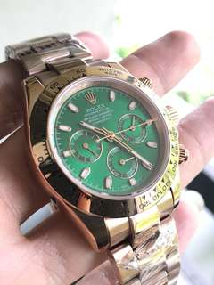 ROLEX DAYTONA gold and green