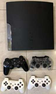 PS3 Slim w Controllers and Games Fast Deal