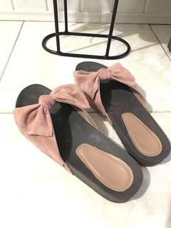 Symbolic sandals