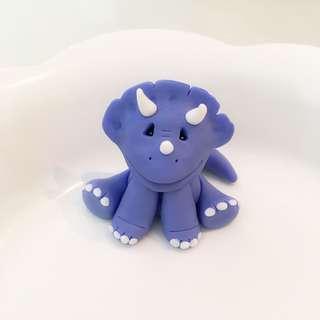 Customized triceratops dinosaur fondant cake or cupcake topper