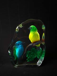 Glass display with colorful birds