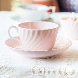 Pretty vintage swirl-shaped bone china cup and saucer, collectible Minton shell pink