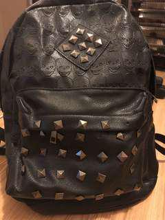 Studded black skull backpack