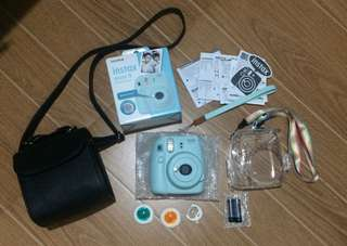 Instax Mini 9 (Ice Blue) with Leather Bag, Clear Case and others