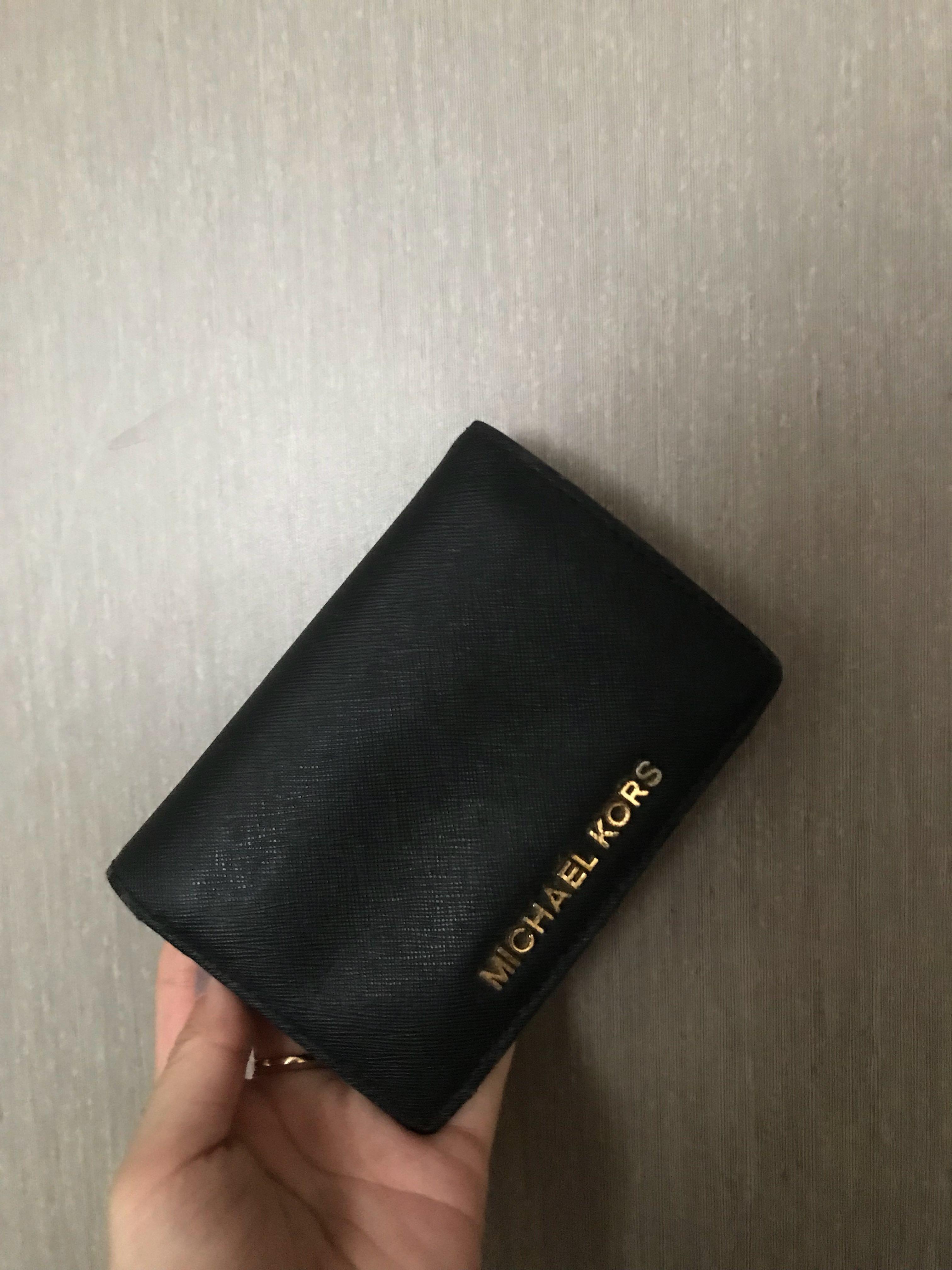 5981aa159059 preloved michael kors black small wallet, Luxury, Bags & Wallets, Wallets  on Carousell