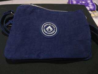 Comfortable nylon sling bag with 🙊 icon