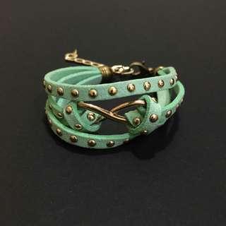 Infinity green colour bracelet