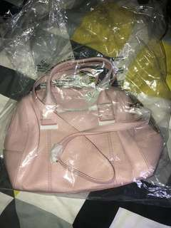 Satchel pink fossil