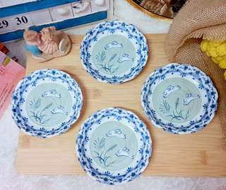 bunny couple jumping on the grass blue & white porcelain dessert plate set