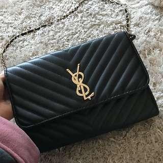 Black and gold YSL bag