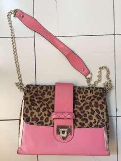 Pink cheetah print sling bag