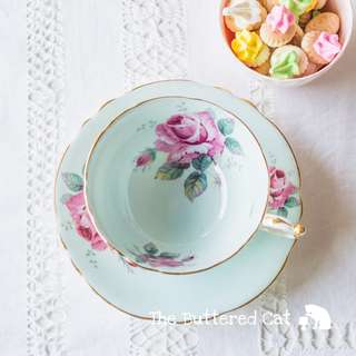 Lovely vintage Paragon cabinet teacup and saucer with large, vivid pink rose