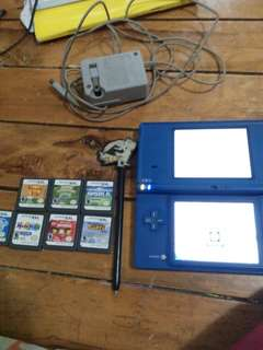 Nintendo DS i with charger and 8 video cards