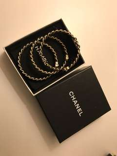 Chanel Bangles, set of three in gold and black