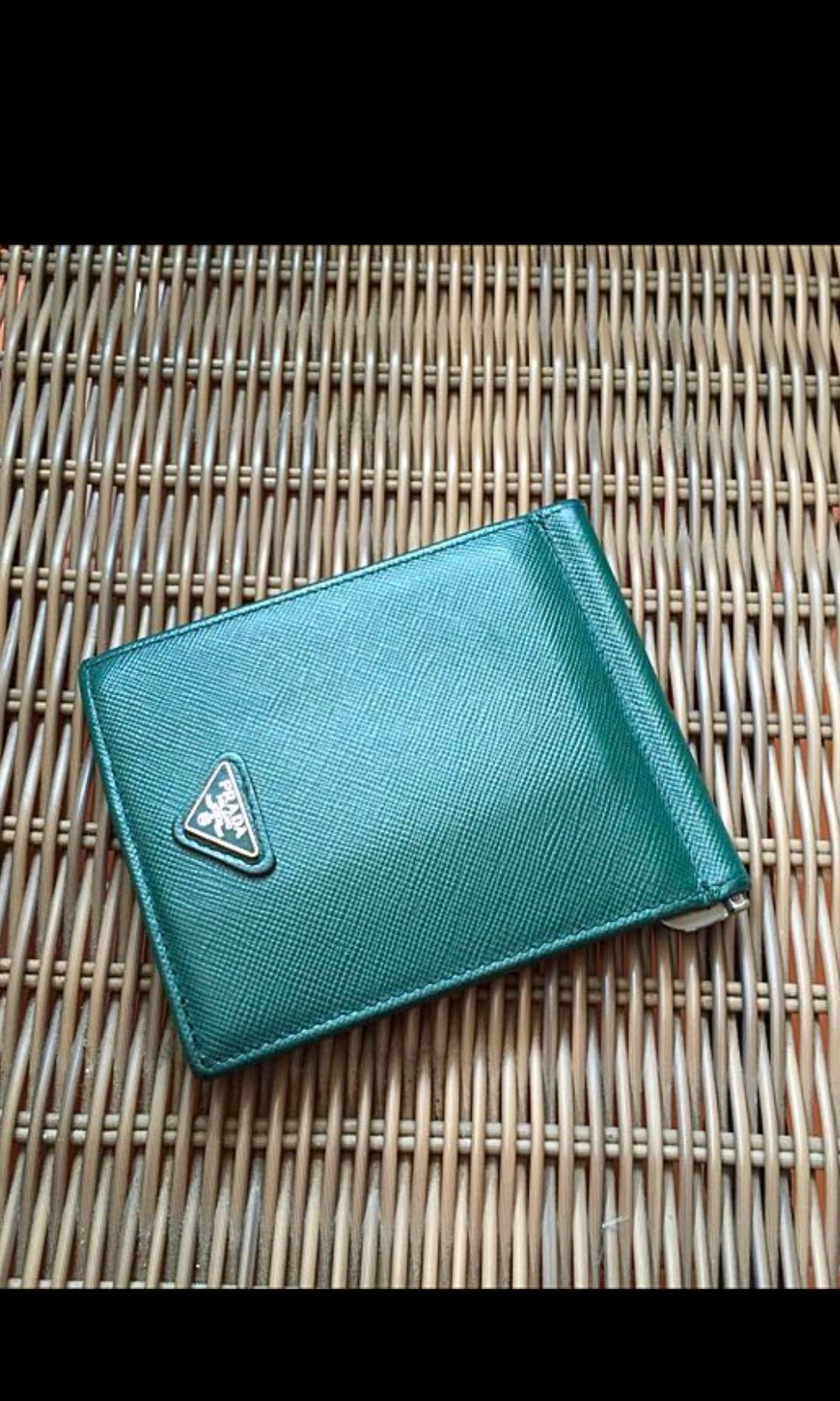 81140a2aae5f Prada money clip wallet, Luxury, Bags & Wallets, Wallets on Carousell