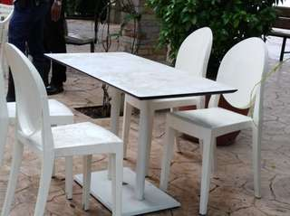 one set plastic chairs and table