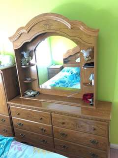 A bed set with a mirror dresser and two night tables