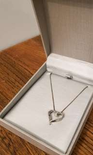 0.14 CT. T.W. Diamond Heart Pendant in Sterling Silver From People's