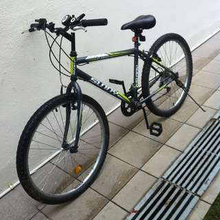 Used Mountain bicycle. In usuable condition. Can ride home.