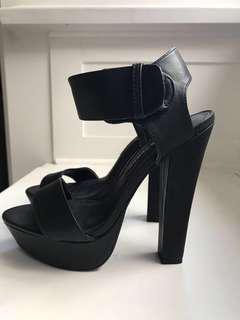 Famous footwear store. Platform Heels with thick ankle strap