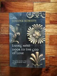 """Living Next Door to the God of Love"", Justina Robson"