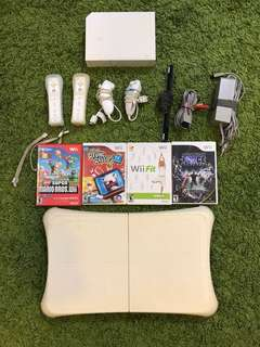 Wii consoles, games, and yoga pad