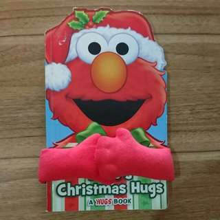 Elmo's Christmas Hugs Board Book